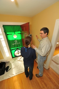A blower door is used to measure and locate air-leakage in a home