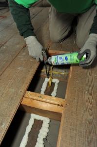 More attic insulation is good--but make sure you air-seal, first.  Here we're foaming gaps a a interior patition wall and wiring holes.