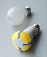 Incandescent bulb shown next to LED bulb