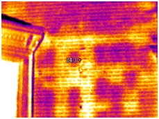 Infrared image showing thermal defects in a house